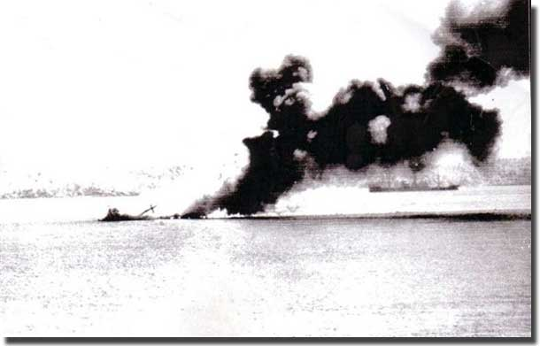 MV Macdhui burning and sinking in Port Moresby Harbour after two days of bombing by Japanese aircraft