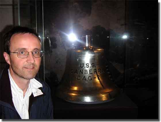 Raymond Edwin Gregory with the Bell on display in the American Gallery, at the Australian National Maritime Museum at Darling Harbour Sydney.