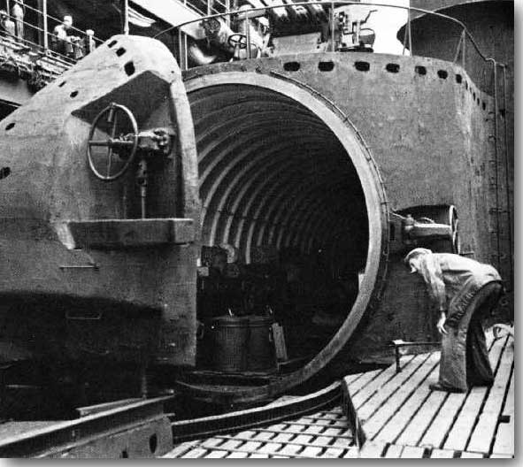 The huge hangar door open on the deck of an I-400 class Japanese Submarine, probably this is I-401.