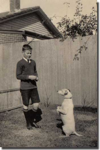 Me with my fox terrier BOB, about 1935, having just sat for the Naval College entrance examination.