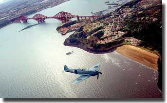 A Spitfire flies over the famous Forth Bridge in 1999 as part of a reunion of the surviving members of the Edinburgh 603 and Glasgow 602 squadrons