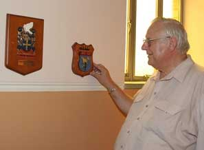 Fr Hilder examines some of the US ships' plaques in the American chapel.