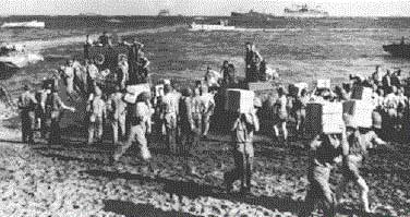 U.S. marines bring supplies ashore in the first days of the Guadalcanal campaign in August 1942.