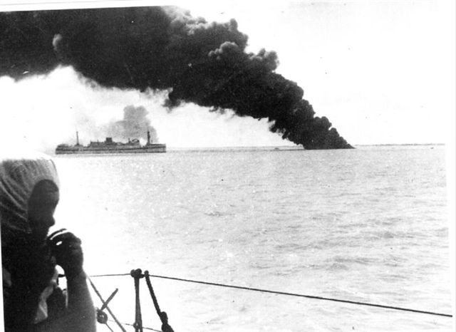 USS Peary on fire and sinking in Darwin Harbour 19th. February 1942