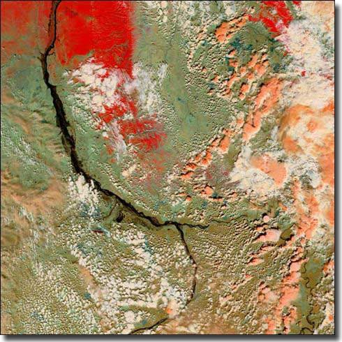 Flooding on the Lena river. The Delta covered in ice shows as red, the River would normally show as a black line, with land areas dull green or tan.